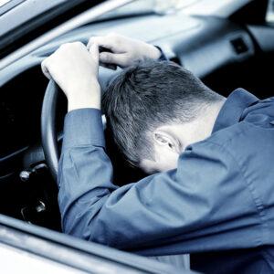 Young Man sleep in a Car